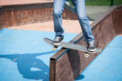 Skater. Jumps high in air under extrem-park Royalty Free Stock Images
