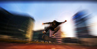 Skater jumps high in air under extrem-park Stock Photography