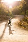 Skater long boarder speed  skater magic hour Royalty Free Stock Image