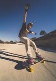 Skater longo da velocidade do borrão da velocidade do pensionista do skater Imagem de Stock