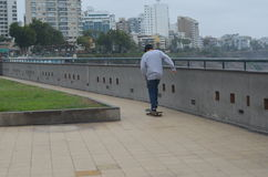 Skater looking the ocean from a pointview in Larco Mall in Lima, Perú Royalty Free Stock Photo