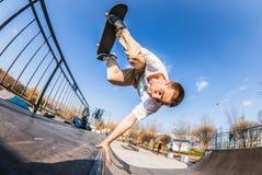 Skater make handplant in mini ramp in skatepark royalty free stock photos