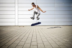 Skater making a flip. With his skateboard Royalty Free Stock Image