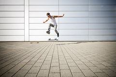 Skater making a flip. With his skateboard royalty free stock images