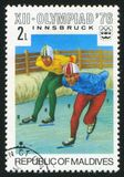 Skater. MALDIVE ISLANDS - CIRCA 1975: stamp printed by Maldive Islands, shows skater, circa 1975 royalty free stock image