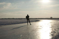 Skater on natural ice in the Netherlands royalty free stock images