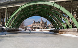 Skater passes under bridge on the Rideau Canal Stock Image