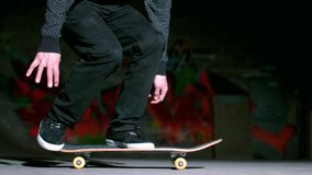 Skater performing 360 flip trick Royalty Free Stock Photos