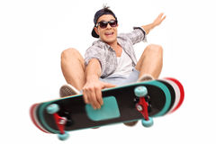 Skater performing tricks with his skateboard Royalty Free Stock Photography