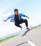 Skater playing skateboard with flipping trick Royalty Free Stock Photo