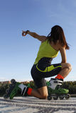 Skater pointing to the sky. In Spain in summer Royalty Free Stock Image