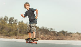 Skater. Riding on the road at sunset stock image