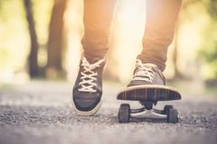 Skater riding a skateboad. Close up on feet stock image