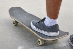Skater and skateboard legs detail. Lifestyle urban background. Royalty Free Stock Photos