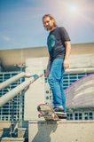 Skater standing next to the rails. Free ride street skateboarding Royalty Free Stock Image