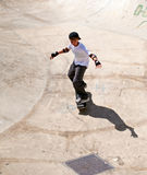 Skater teen . Boy rides his skateboard on the site for a skateboard stock photo