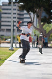 Skater teen . Boy rides his skateboard on the site for a skateboard Royalty Free Stock Images