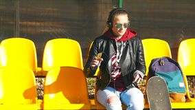 Skater teen is listening music. stock video footage