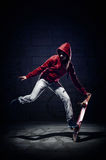 Skater trick. Skateboarder doing trick with grunge background red hoodie and skill stock photos