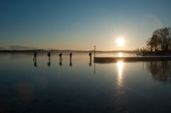 Skaters. A group of adventure skaters on sea ice royalty free stock photos