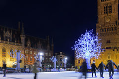 Skaters at Christmas in Grote Markt with Belfort Royalty Free Stock Photos