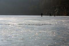 Skaters at a lake Stock Photos