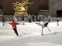 Skaters Rockefeller Center. This is a blur action shot of some very good skaters at Rockefeller Center in Manhattan royalty free stock photos