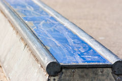Skaters training half pipe rail in the park close up. Skaters training half pipe rail in the park close up view in angle stock photo
