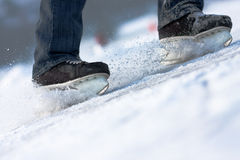 Skates 2. Aggressive breaking on ice. Concept of speed and power stock photography