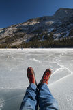 Skates. Ice skating on Tenaya Lake in Yosemite National Park, in December Royalty Free Stock Photo