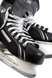 The skates. There ia a part of hockey skates on the white background Stock Image