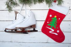 Skates and christmas sock and pine branches Royalty Free Stock Photo
