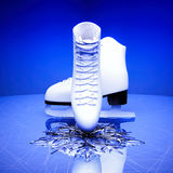 The skates for figure skating and a snowflake. Stock Images