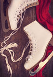 Skates for figure skating on a wooden background Royalty Free Stock Image
