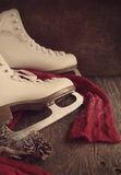 Skates for figure skating on a wooden background Stock Images