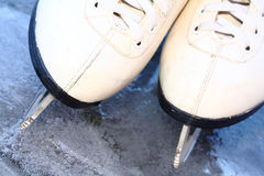 Skates on ice Stock Photography