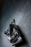 The skates weigh on the wall Stock Photography