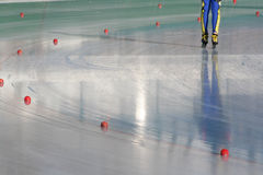 Skating. A speedskater races on the ice stock images