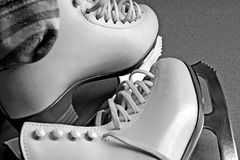 Skating Boots. A pair of white skating boots rendered in grayscale royalty free stock photography