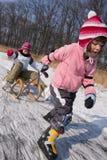 Skating children fun on snow Royalty Free Stock Photo