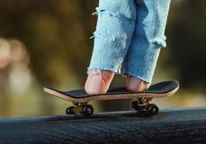 Skating on the fingerboard, training process. Closeup Royalty Free Stock Image