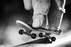 Skating on the fingerboard, training process. Closeup Stock Images