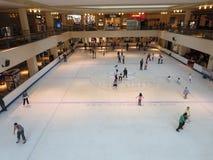 Skating hall inside a mall. People enjoying in a skating hall royalty free stock photos
