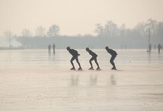 Skating in Holland. Picture of Winter in Holland, snow and people recreating on the ice Royalty Free Stock Photos