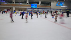 Skating on ice rink Stock Images