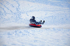 Skating with ice slides on a tubing Stock Photography