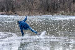 Man falling down while ice skating. Snow skates from the scatter in the parties royalty free stock photos