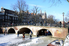 Skating near bridge over Keizergracht in Amsterdam Royalty Free Stock Photo