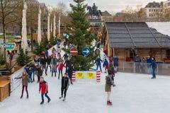 Skating people ice rink at traditional Christmas market centre Koln. KOLN, GERMANY - DECEMBER 9, 2017: Skating people at ice rink at traditional Christmas market Royalty Free Stock Photo
