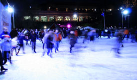 The Skating Rink. Action shot of people skating on an outdoor ice rink royalty free stock photography